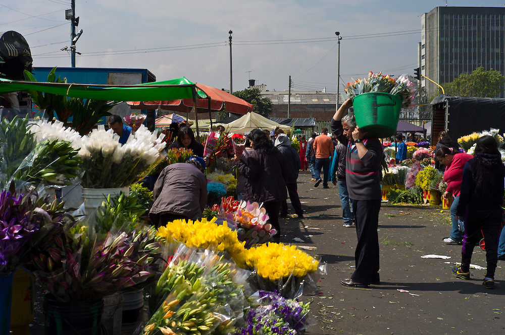 Flower sellers packing up at the Paloquemao Market in Bogotá, Colombia.