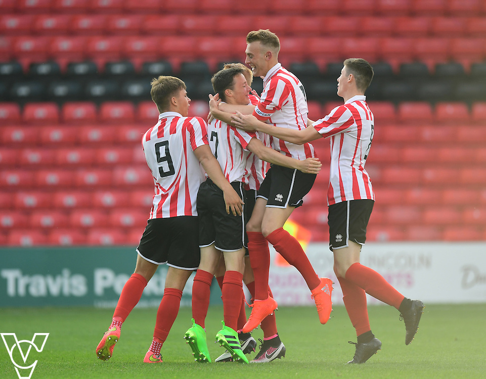 Lincoln City&rsquo;s Ritchie Burdett, second in from left, celebrates scoring the opening goal with team-mates<br /> <br /> Lincoln City under 18s Vs Leicester City under 18s at Sincil Bank, Lincoln.<br /> <br /> Picture: Chris Vaughan/Chris Vaughan Photography<br /> <br /> Date: July 28, 2016