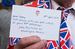 © London News Pictures. 30/04/2015. Royal fan Terry Hutt holding a card sent to him by staff at Kensington Palace on his 80th birthday as he waits outside Lindo Wing of St Mary's hospital in Padding, where The Duchess is due to give birth. Photo credit: Ben Cawthra/LNP