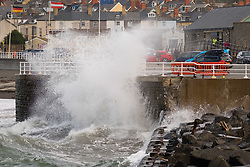 ©Licenced to London News Pictures - Aberystwyth, UK. 30/09/2018. Blustery cold winds at high tide bring big waves crashing against the harbour wall in Aberystwyth on the Cardigan Bay coast, west Wales on the last day of September 2018<br />