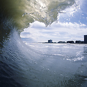 A wave breaks near Pelican Watch on the shore of Carolina Beach, NC.