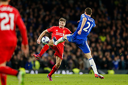 Steven Gerrard of Liverpool faces a high boot from Nemanja Matic of Chelsea during extra time - Photo mandatory by-line: Rogan Thomson/JMP - 07966 386802 - 27/01/2015 - SPORT - FOOTBALL - London, England - Stamford Bridge - Chelsea v Liverpool - Capital One Cup Semi-Final Second Leg.