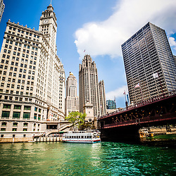 Downtown Chicago buildings photo includes  Wrigley Building, Tribune Tower, The Equitable Building, Michigan Avenue Bridge (DuSable Bridge) and the Chicago River. Photo is high resolution.