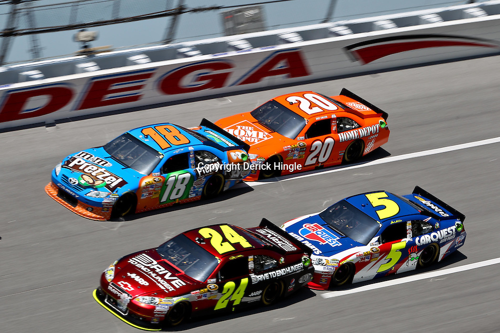 April 17, 2011; Talladega, AL, USA; NASCAR Sprint Cup Series driver Joey Logano (20) drafts with Kyle Busch (18) and Mark Martin (5) drafts with Jeff Gordon (24) during the Aarons 499 at Talladega Superspeedway.   Mandatory Credit: Derick E. Hingle