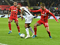 Football - 2019 / 2020 Sky Bet (EFL) Championship - Swansea City vs. Fulham<br /> <br /> André Ayew of Swansea City has his shirt held by Joe Bryan of Fulham, at The Liberty Stadium.<br /> <br /> COLORSPORT/WINSTON BYNORTH