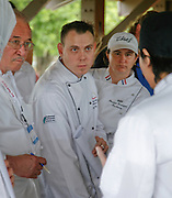Chefs Jerry Oliverri (left), Yancy Voges, and Christina Perrington listen to Tim Bagnas (right) talk about his entree. High school students from some of San Antonio's high school culinary programs compete for St. Philip's College Culinary School scholarships during the City South Festival Culinary Competition, held at Brooks City-Base, Texas on March 25, 2007.  Judging was performed by chefs from the San Antonio Chapter of the Texas Chefs Association.  (Photos/Lance Cheung) ..PHOTO COPYRIGHT 2007 LANCE CHEUNG.This photograph is NOT within the public domain..This photograph is not to be downloaded, stored, manipulated, printed or distributed with out the written permission from the photographer. .This photograph is protected under domestic and international laws.