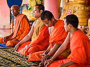 19 JUNE 2016 - DON KHONE, CHAMPASAK, LAOS:  Buddhist monks leads a service in a temple in Don Khone village on Don Khone Island. Don Khone Island, one of the larger islands in the 4,000 Islands chain on the Mekong River in southern Laos. The island has become a backpacker hot spot, there are lots of guest houses and small restaurants on the north end of the island.   PHOTO BY JACK KURTZ