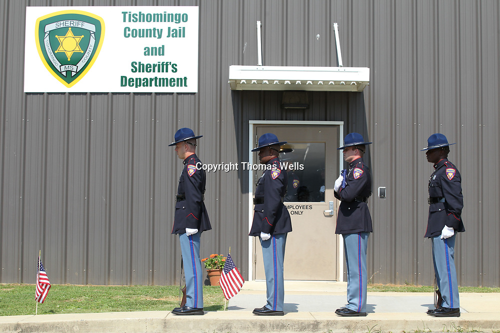 Members of the Mississippi High Patrol Honor Guard stand ready to begin the flag dedication for MBN officer Lee tartt who killed in 2016 during a standoff in Tishomingo County.