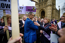 © Licensed to London News Pictures. 08/03/2017. London, UK. Labour MP CHUKA UMUNNA takes a break from media interviews to join woman campaign with the group WASPI (Women Against State Pension Inequality), outside The House of Parliament in London, on the day that  British chancellor Philip Hammond delivers his 2017 Budget to Parliament. Photo credit: Ben Cawthra/LNP