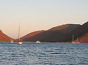 Sailboats sit at sunset in Ensenada Grande, Isla Partida, La Paz, BCS, Mexico; Jan 2010