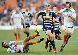 Jean de Villiers of the DHL Stormers chasing a kick with teammate Dewaldt Duvenhage right behind him while Naas Olivier of the Toyota Cheetahs looks on from the ground and Waltie Vermeulen backing up on defense during the Super Rugby (Super 15) fixture between the DHL Stormers and the Cheetahs held at DHL Newlands Stadium in Cape Town, South Africa on 26 February 2011. Photo by Jacques Rossouw/SPORTZPICS