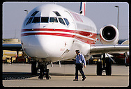 Ramp worker listens to TWA pilot on intercom before jet departs @ Lambert Intl Airport; St. Louis. Missouri