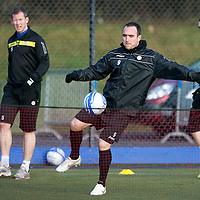 St Johnstone FC Training...27.01.12<br /> Lee Croft playing a game of football tennis with his team mates during training at McDiarmid Park this morning.<br /> Picture by Graeme Hart.<br /> Copyright Perthshire Picture Agency<br /> Tel: 01738 623350  Mobile: 07990 594431