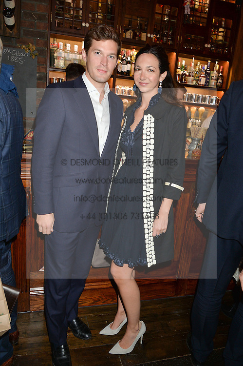 ARCHIE LORD and CELIA WEINSTOCK at the opening party of Mr Fogg's Tavern, 58 St.Martin's Lane, London hosted by William Sitwell on 8th October 2015.