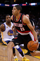 Feb 15, 2012; Oakland, CA, USA; Portland Trail Blazers small forward Nicolas Batum (88) dribbles past Golden State Warriors small forward Dorell Wright (1) during the first quarter at Oracle Arena. Mandatory Credit: Jason O. Watson-US PRESSWIRE