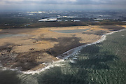 Nederland, Zuid-Holland, Gemeente Westland, 22-05-2011; Zandmotor, aanleg van kunstmatig schiereiland door het opspuiten van zand voor de kust ter hoogte van Ter Heijde. Wind, golven en stroming zullen het zand langs de kust verspreiden waardoor breder stranden en duinen ontstaan. De zandmotor is een experiment in het kader van kustonderhoud en kustverdediging. In de achtergrond de kassen van het Westland..Sand Engine or Sand motor, construction of artificial peninsula by the raising of sand for the coast of Ter Heijde (near the Hague). Wind, waves and currents will distribute the sand along the coast yielding wider beaches and dunes along the coastline . The Sand Engine is a experiment for coastal maintenance of coastal defense. In the background the Westland greenhouses..luchtfoto (toeslag); aerial photo (additional fee required); .foto Siebe Swart / photo Siebe Swart