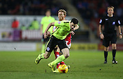 Brighton winger, Jamie Murphy (15) is fouled during the Sky Bet Championship match between Rotherham United and Brighton and Hove Albion at the New York Stadium, Rotherham, England on 12 January 2016.