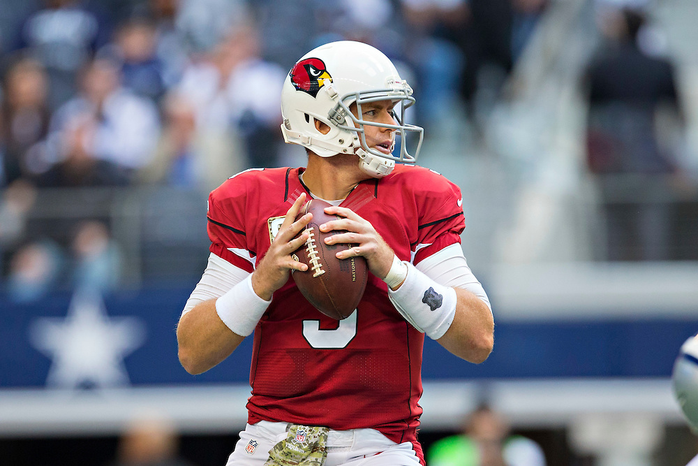 ARLINGTON, TX - NOVEMBER 2:  Carson Palmer #3 of the Arizona Cardinals drops back to pass during the second half of a game against the Dallas Cowboys at AT&T Stadium on November 2, 2014 in Arlington, Texas.  The Cardinals defeated the Cowboys 28-17.  (Photo by Wesley Hitt/Getty Images) *** Local Caption *** Carson Palmer