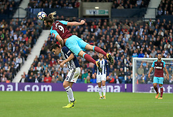 Andy Carroll of West Ham United climbs on Gareth Barry of West Bromwich Albion to win a header - Mandatory by-line: Paul Roberts/JMP - 16/09/2017 - FOOTBALL - The Hawthorns - West Bromwich, England - West Bromwich Albion v West Ham United - Premier League