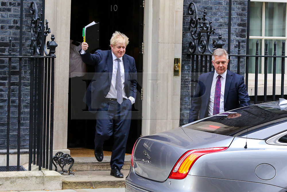 """© Licensed to London News Pictures. 23/10/2019. London, UK. British Prime Minister BORIS JOHNSON departs from Number 10 Downing Street to attend Prime Minister's Questions (PMQs) in the House of Commons. On Tuesday 22 October 2019, MPs rejected Prime Minister BORIS JOHNSON'S fast-track timetable for ratifying the Brexit deal and the government """"paused"""" the parliamentary process — almost certainly ending any prospect of Brexit on 31 October.  Photo credit: Dinendra Haria/LNP"""