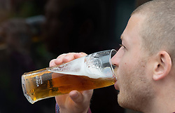 ©Licensed to London News Pictures 04/07/2020     <br /> Petts Wood, UK. A young man enjoying his first pint of the day at The Sovereign of the Seas pub in Petts Wood, South East London. England's pubs pour their first pints today after three months closed due to coronavirus Lockdown. Photo credit: Grant Falvey/LNP