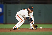 San Francisco Giants shortstop Brandon Crawford (35) scoops up a Cincinnati Reds ground ball at AT&T Park in San Francisco, California, on May 11, 2017. (Stan Olszewski/Special to S.F. Examiner)