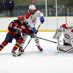 WELLINGTON, ON - OCTOBER 19: Jarrod Croswell #4 of the Kingston Voyageurs battles for position Tyson Gilmour #19 of the Wellington Dukes on October 19, 2018 at Wellington and District Community Centre in Wellington, Ontario, Canada.<br /> (Photo by Ed McPherson / OJHL Images)