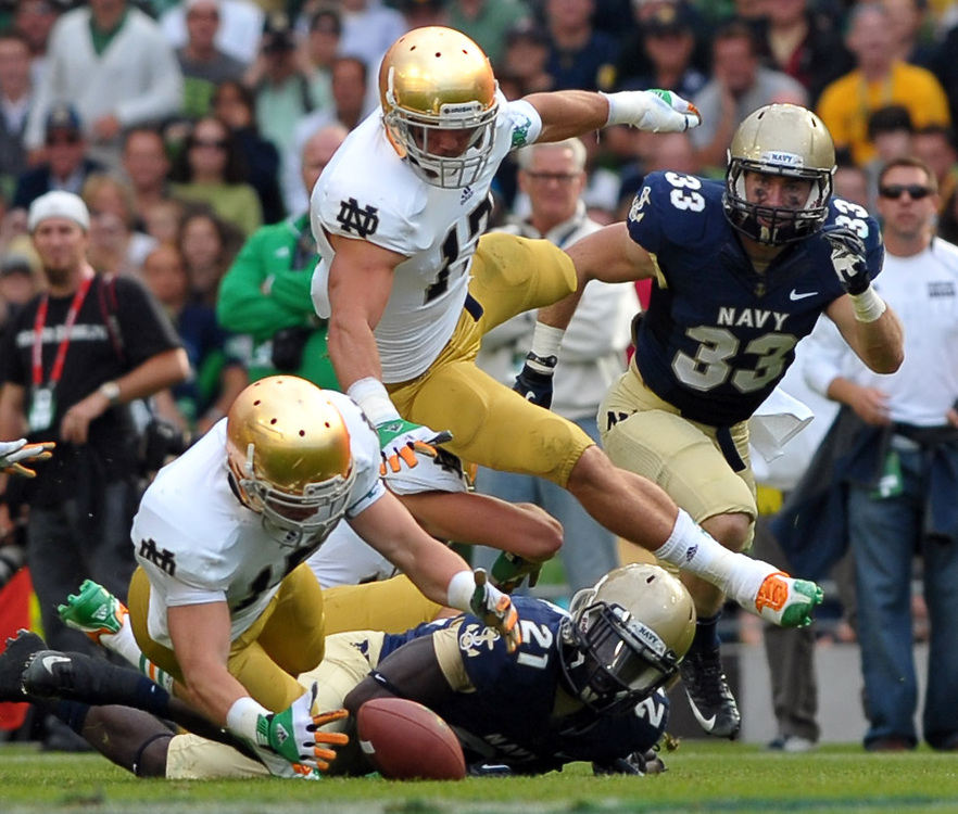 Safety Dan McCarthy (15) pounces on a Navy fumble in the fourth quarter.