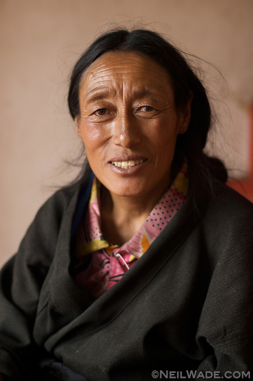 I took this woman's portrait just after the well-dressed woman and the senior monk's.  I think she felt as if she wasn't worthy, but I convinced her to sit for me and she just beamed with excitement.  It's nice to make someone feel special like that.