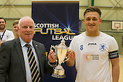 Fair City Santos captain Scott Mollison (right) receives  the Scottish Futsal Cup from Scottish Amateur FA executive committee member Ronnie Hughes after the Perth team had beaten Edinburgh side Wattcell in the final - Scottish Futsal Finals Day at the DISC<br /> <br />  - &copy; David Young - www.davidyoungphoto.co.uk - email: davidyoungphoto@gmail.com