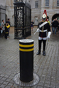 A black mounted lifeguard trooper parades at Horseguards in Whitehall, Westminster, Central London. <br /> This regiment is classed as a corps in its own right, and consists of two regiments: Life Guards (British Army) and the Blues and Royals (Royal Horse Guards and 1st Dragoons). They are the senior regular regiments in the British Army, with traditions dating from 1660.
