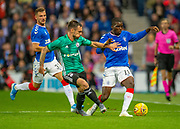 Sheyi Ojo (#11) of Rangers FC holds off Marko Vesovic (#29) of Legia Warsaw during the Europa League Play Off leg 2 of 2 match between Rangers FC and Legia Warsaw at Ibrox Stadium, Glasgow, Scotland on 29 August 2019.