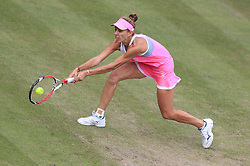 Mihaela Buzarnescu in action against Petra Kvitova during their semi final match on day six of the Nature Valley Classic at Edgbaston Priory, Birmingham.