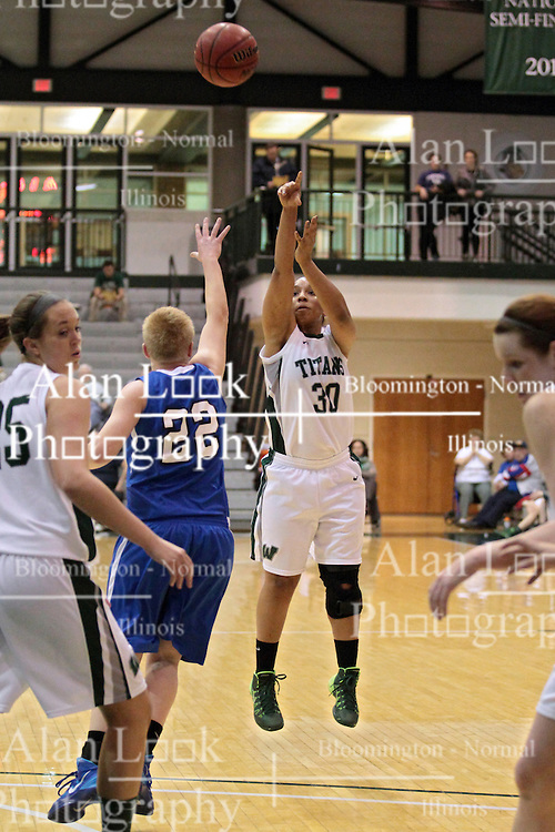 15 January 2014:  Gabrielle Holness & Yip Ypya during an NCAA women's division 3 basketball game between the Millikin Big Blue and the Illinois Wesleyan Titans in Shirk Center, Bloomington IL