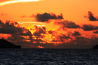 view from a sailling boat of a sunset on saint anne 's bay in praslin seychelles islands indian ocean