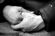 Hands of homeless man in shelter.