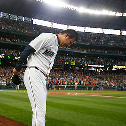 Seattle Mariners pitcher Hisashi Iwakuma (18) bows to the fans following the final out of his no-hit, 3-0 victory against the Baltimore Orioles at Safeco Field.