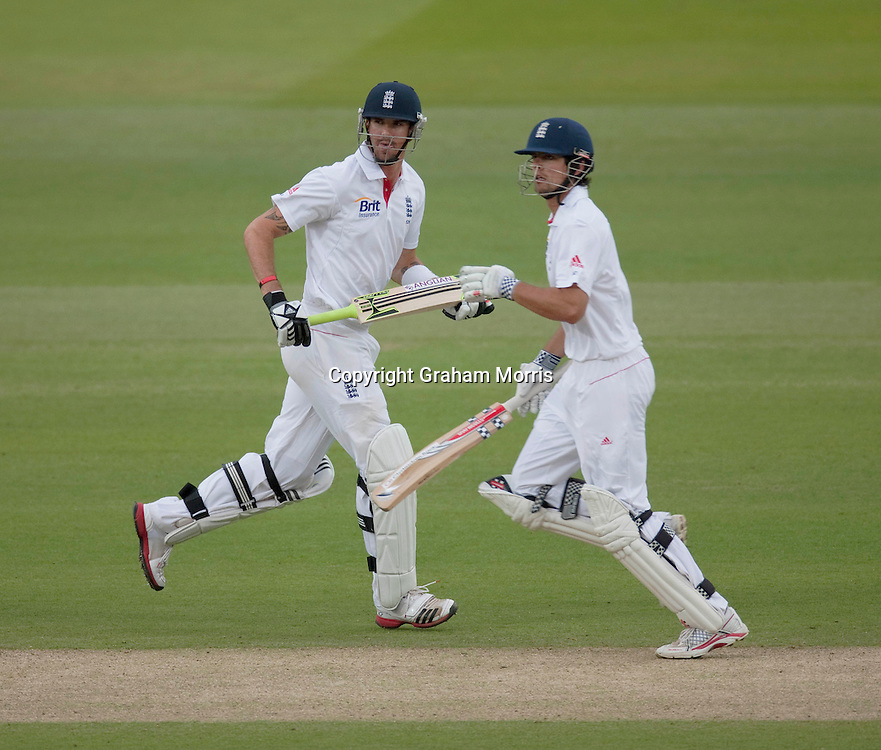 Kevin Pietersen runs past Alastair Cook (right) during the second npower Test Match between England and Sri Lanka at Lord's.  Photo: Graham Morris (Tel: +44(0)20 8969 4192 Email: sales@cricketpix.com) 06/06/11