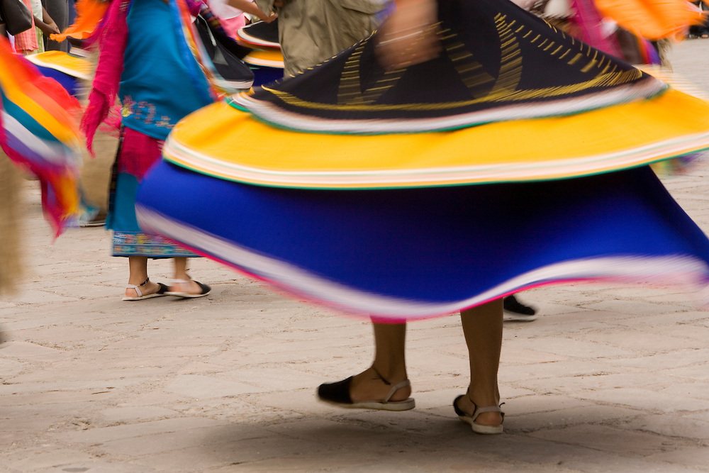 South America, Ecuador, Cuenca.  Swirling skirt of female dancer in folklore troupe during annual parade and festival to celebrate founding of Cuenca in 1557.  Cuenca is a UNESCO World Heritage Site.
