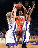 Oklahoma State forward Dominque Schism (C) puts up a shot between pressure from Kansas State defenders Danielle Zanotti (L) and Shana Wheeler (R), during second half action at Bramlage Coliseum in Manhattan, Kansas, February 28, 2007.  Oklahoma State beat K-State 64-55.