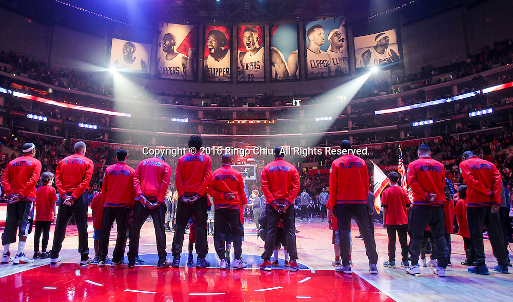 Members of the Los Angeles Clippers stand on the court during the national anthem before an NBA basketball game against Charlotte Hornets in Los Angeles, the United States, Jan. 9, 2016. Los Angeles Clippers won 97-83. (Xinhua/Zhao Hanrong)(Photo by Ringo Chiu/PHOTOFORMULA.com)<br /> <br /> Usage Notes: This content is intended for editorial use only. For other uses, additional clearances may be required.