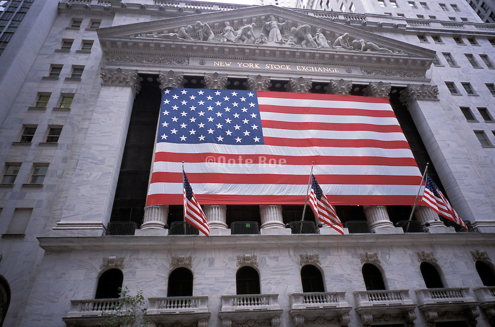 Big American flag hung on the NY Stock Exchange