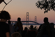 Spectators in Mackinaw City wait for the start of simultaneous fireworks displays on both ends of the Mackinaw Bridge as part of the bridges 50th anniversary celebrations.