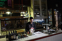 ROME, ITALY - 6 January 2014: A waiter prepares  bucket for a bottle of wine for customers have dinner at Primo al Pigneto restaurant, opened by Chef Marco Gallotta in 2006 in the Pigneto neighborhood of Rome, Italy, on February 6th 2014.