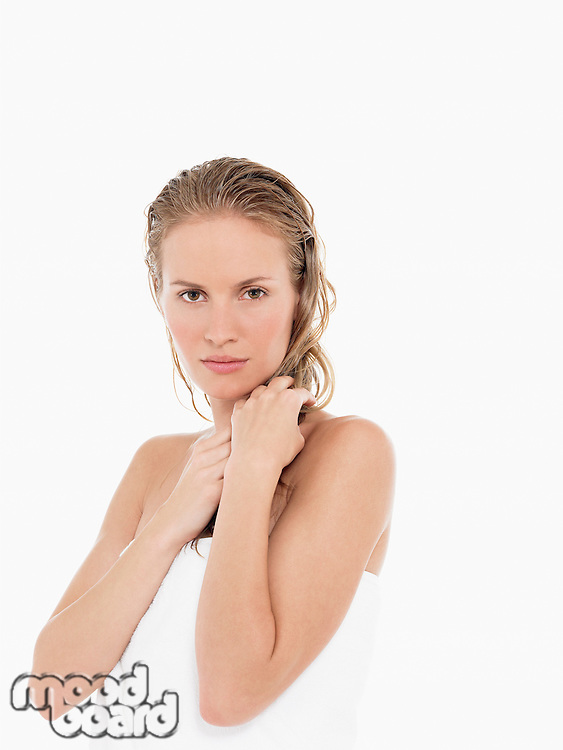 Young Blond Woman in towel with wet hair portrait