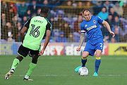AFC Wimbledon defender Barry Fuller (2) passing the ball during the EFL Sky Bet League 1 match between AFC Wimbledon and Plymouth Argyle at the Cherry Red Records Stadium, Kingston, England on 21 October 2017. Photo by Matthew Redman.