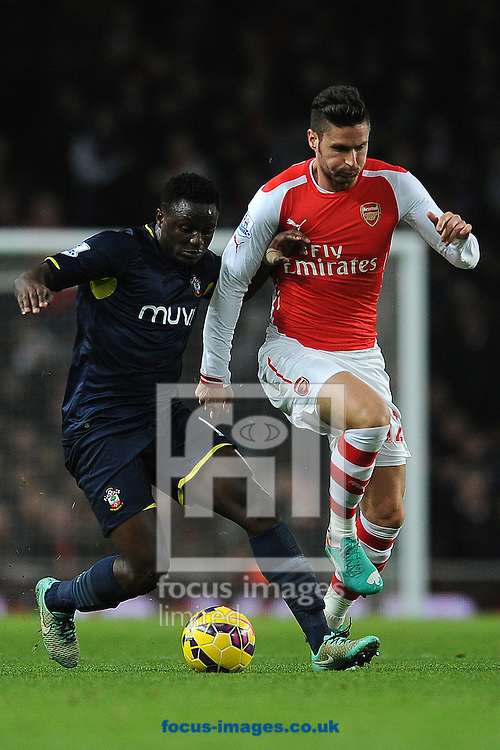Victor Wanyama of Southampton does battle with Olivier Giroud of Arsenal during the Barclays Premier League match between Arsenal and Southampton at the Emirates Stadium, London<br /> Picture by Richard Blaxall/Focus Images Ltd +44 7853 364624<br /> 03/12/2014