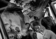 Liberian boys who fled from their home country to the border village of Mandopulahun. In Liberia they risked being drafted as go-vernment soldiers or rebel fighters – both sides forced child-ren to take part in the bitter war.  June 2002.