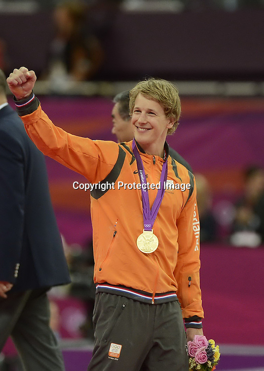 Aug 07, 2012; London, ENGLAND; Gold medalist Epke Zonderland of Netherlands poses on the podium after the Artistic Gymnastics Men's Horizontal Bar final on Day 11 of the London 2012 Olympic Games at North Greenwich Arena.