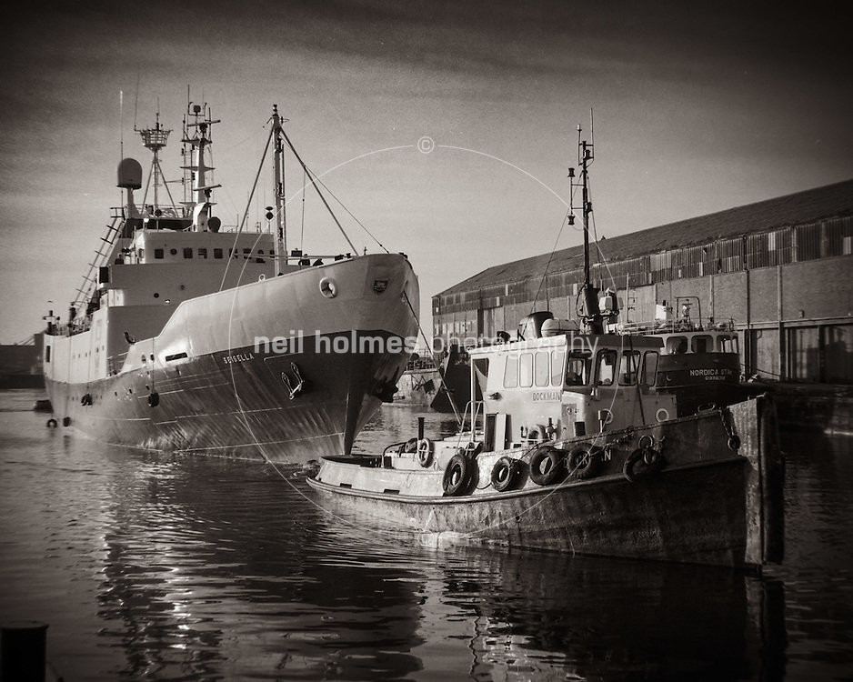 William Right Dock, Kingston Upon Hull, East Yorkshire, United Kingdom, 17 December, 1986. Pictured: J Marr Vessel Seisella & tug Dockman